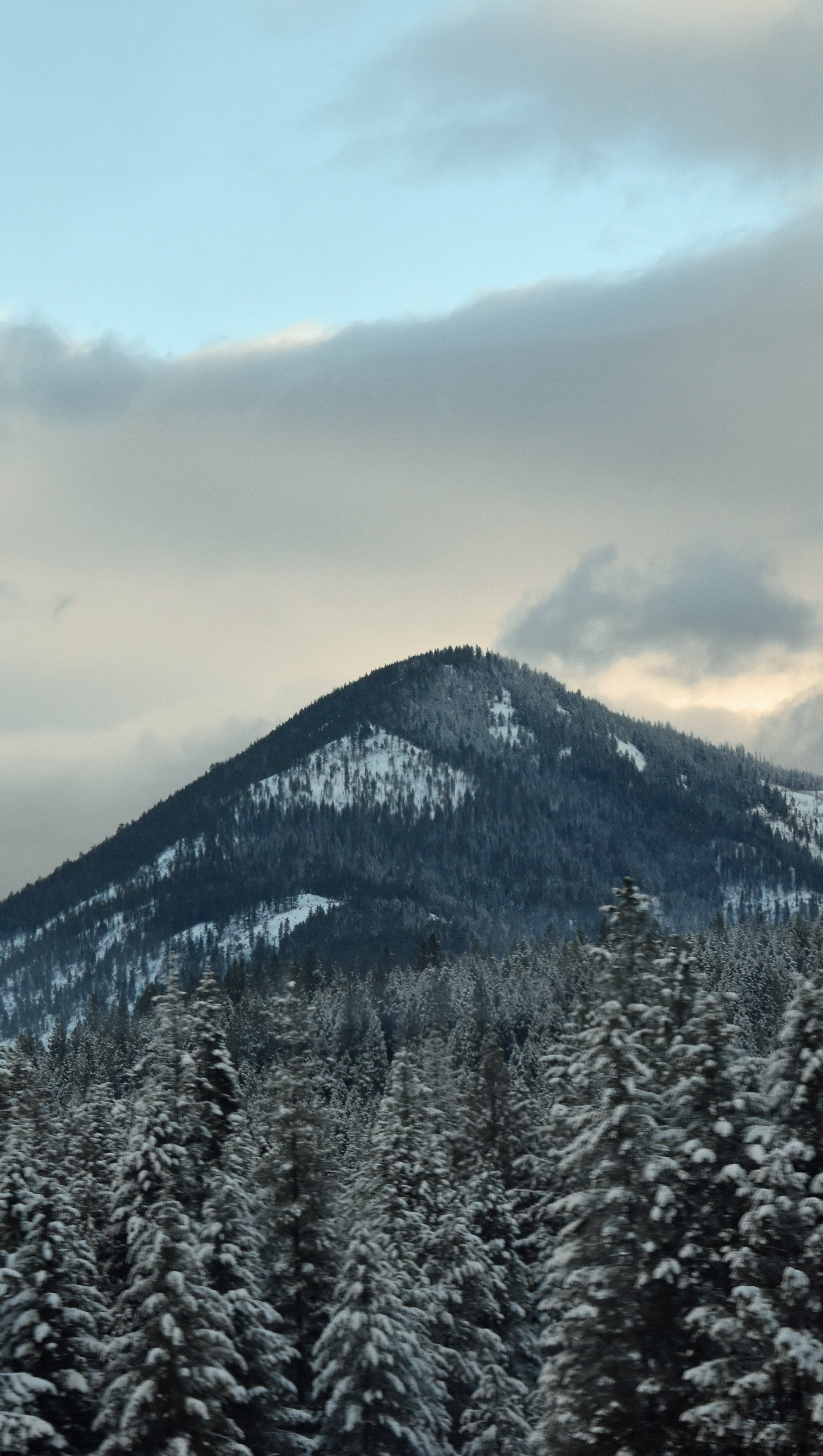 Wallpaper Peak of mountain in the winter Vertical