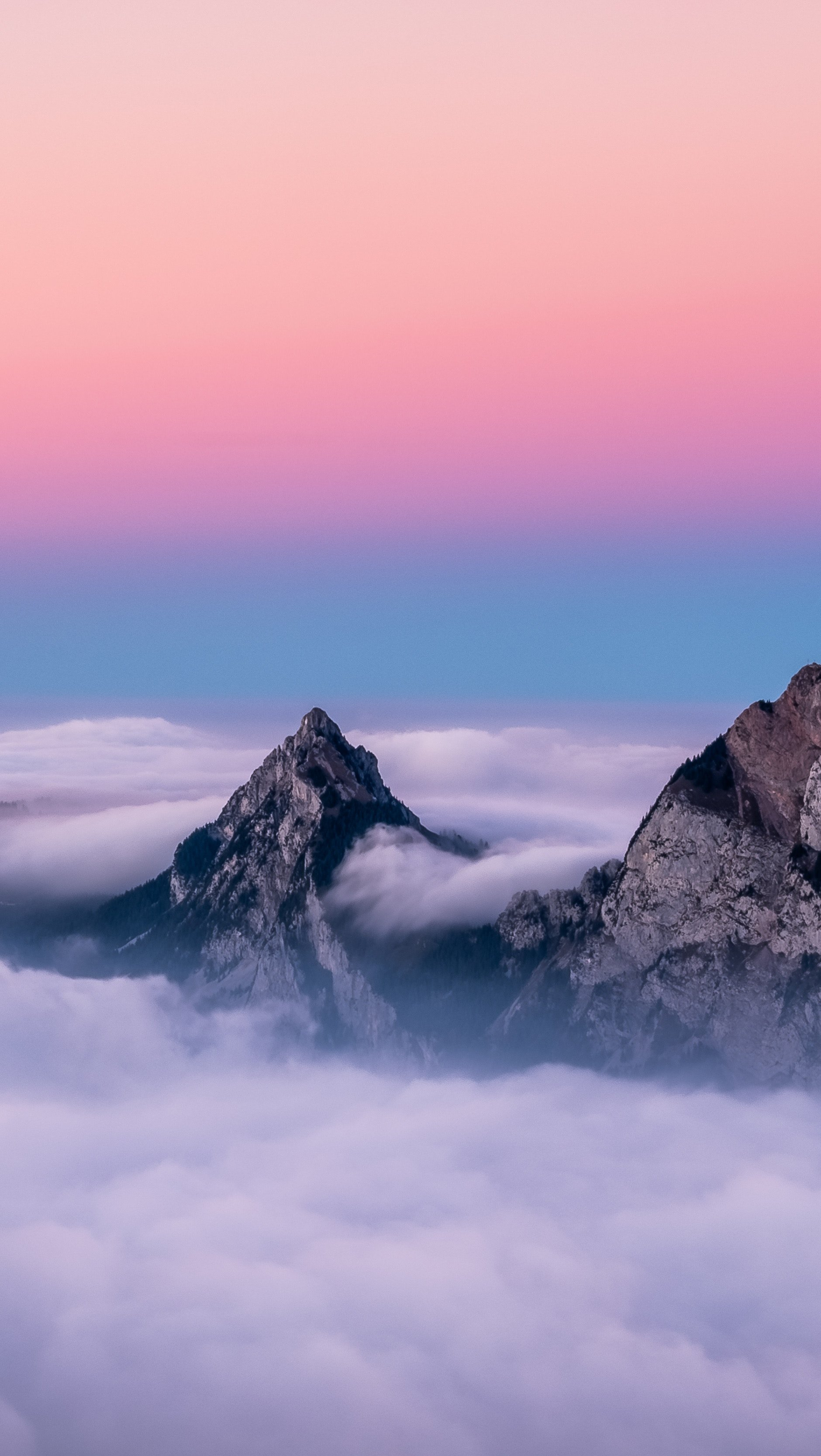 Wallpaper Twin Peaks Mountains in Clouds Vertical