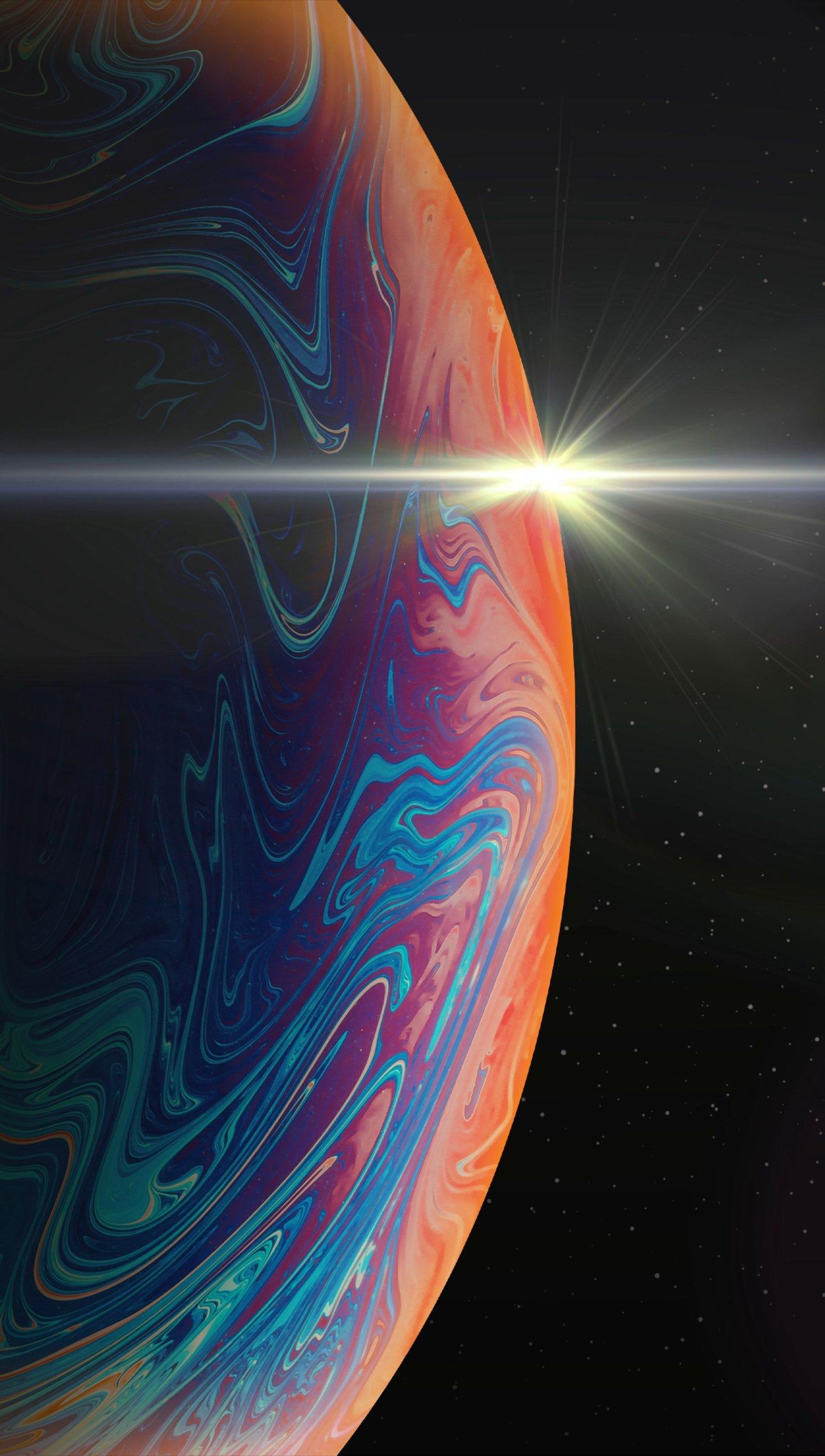 Fondos de pantalla Planeta de colores a la luz del sol Vertical