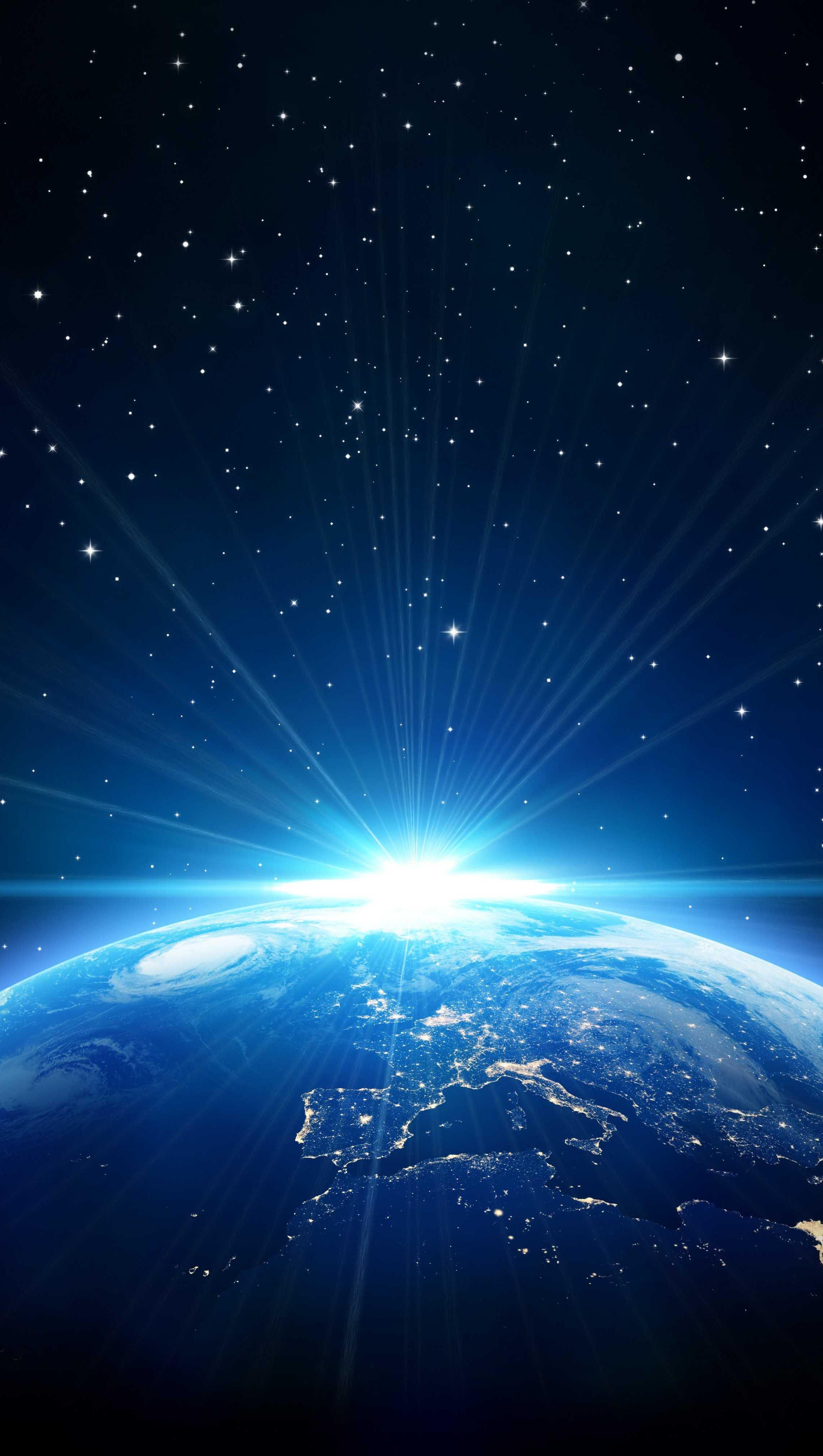 Fondos de pantalla Planeta tierra con destello de luz Vertical