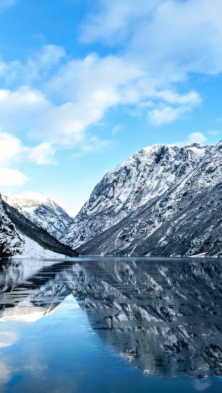 Wallpaper Norway river between mountains Vertical