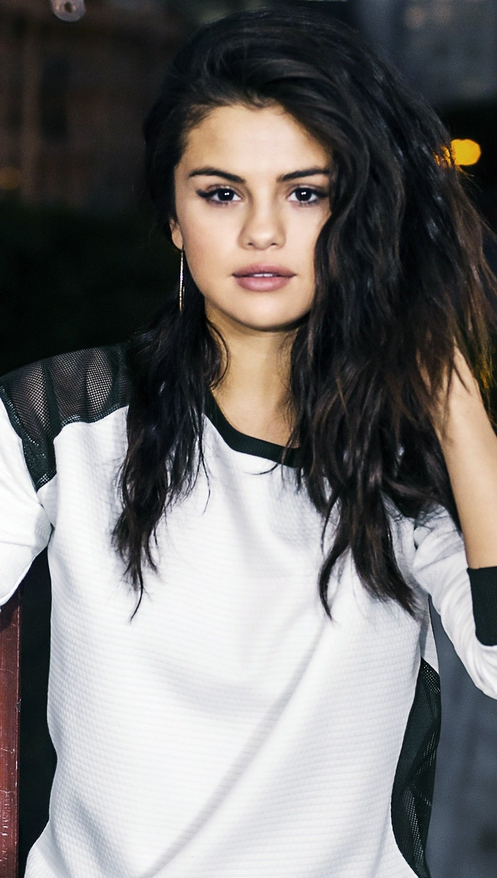 Wallpaper Selena Gomez in a window Vertical