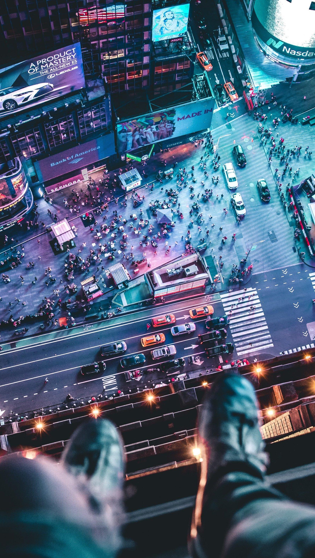 Fondos de pantalla Vista aerea de Nueva York con hombre sentado Vertical